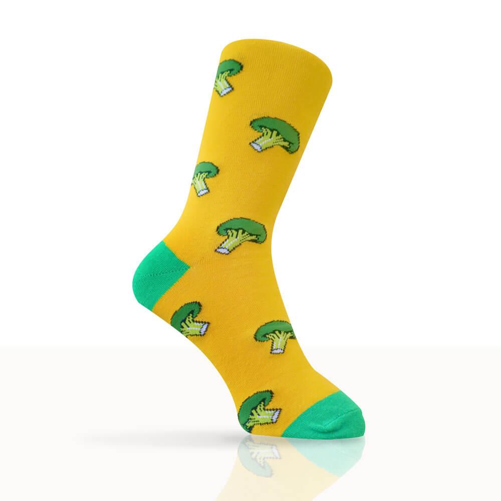 Yellow socks with green broccoli