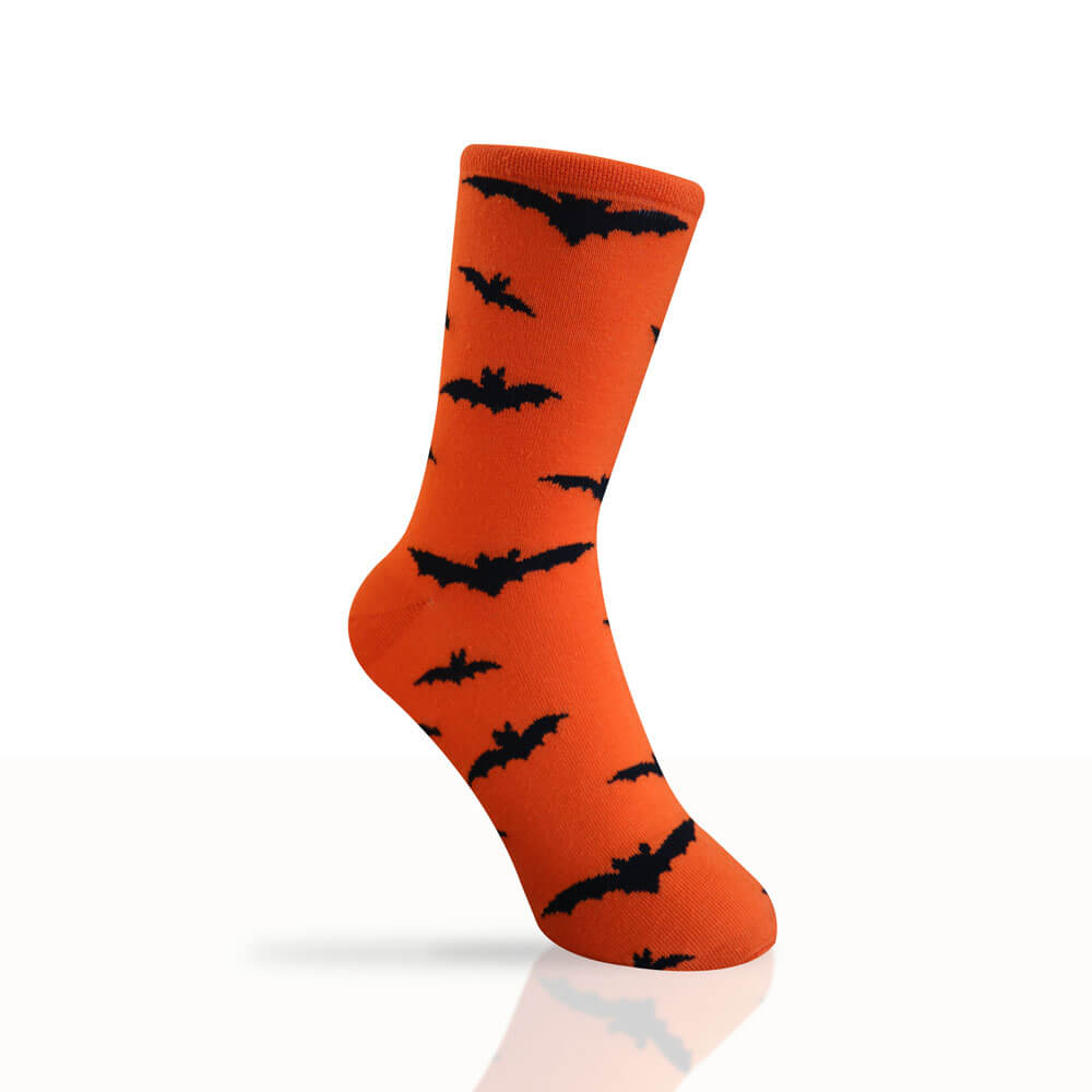 bright orange socks with bats pattern